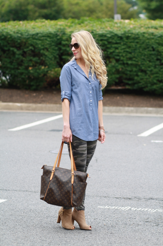 chambray denim tunic button down shirt, camo skinny pants, Louis Vuitton MM tote, tan Stuart Weitzman peep-toe booties, Prada sunglasses