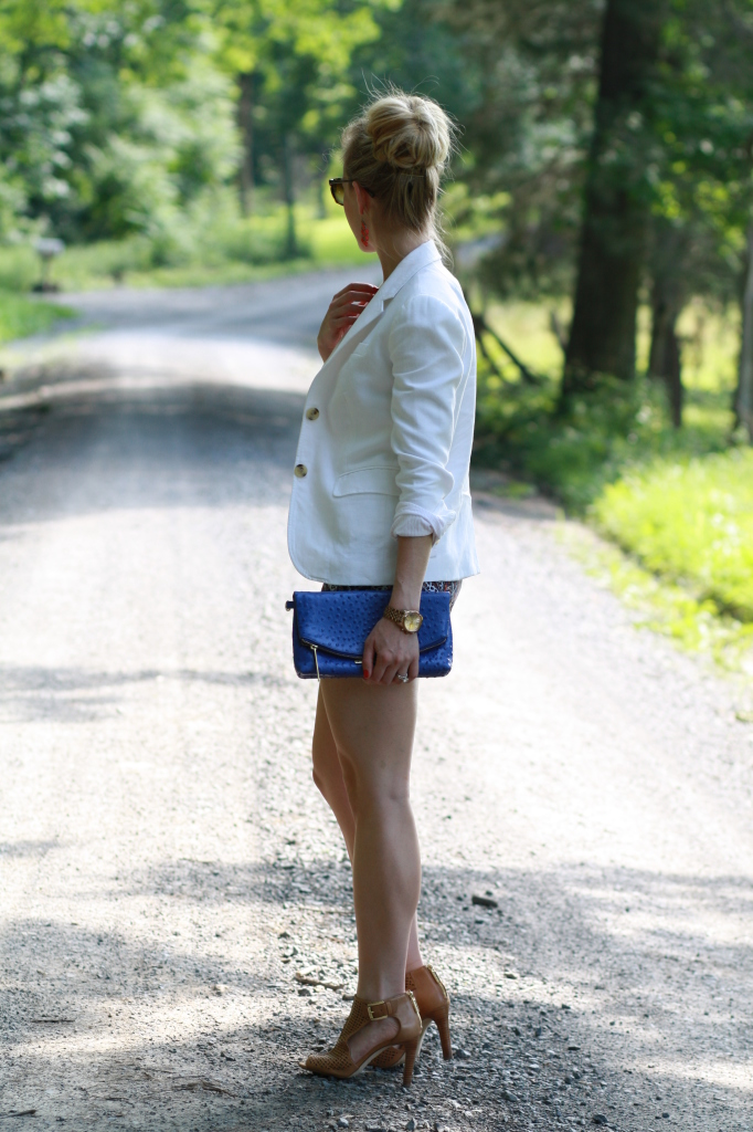 sock bun, white blazer, paisley shorts, cobalt blue Brahmin Duxbury clutch, tan perforated leather peep-toe booties