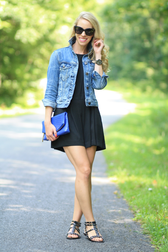 J. Crew vintage distressed denim jacket, black romper, Sam Edelman black studded flat gladiator sandals, cobalt blue Brahmin duxbury clutch, Chanel oversized sunglasses