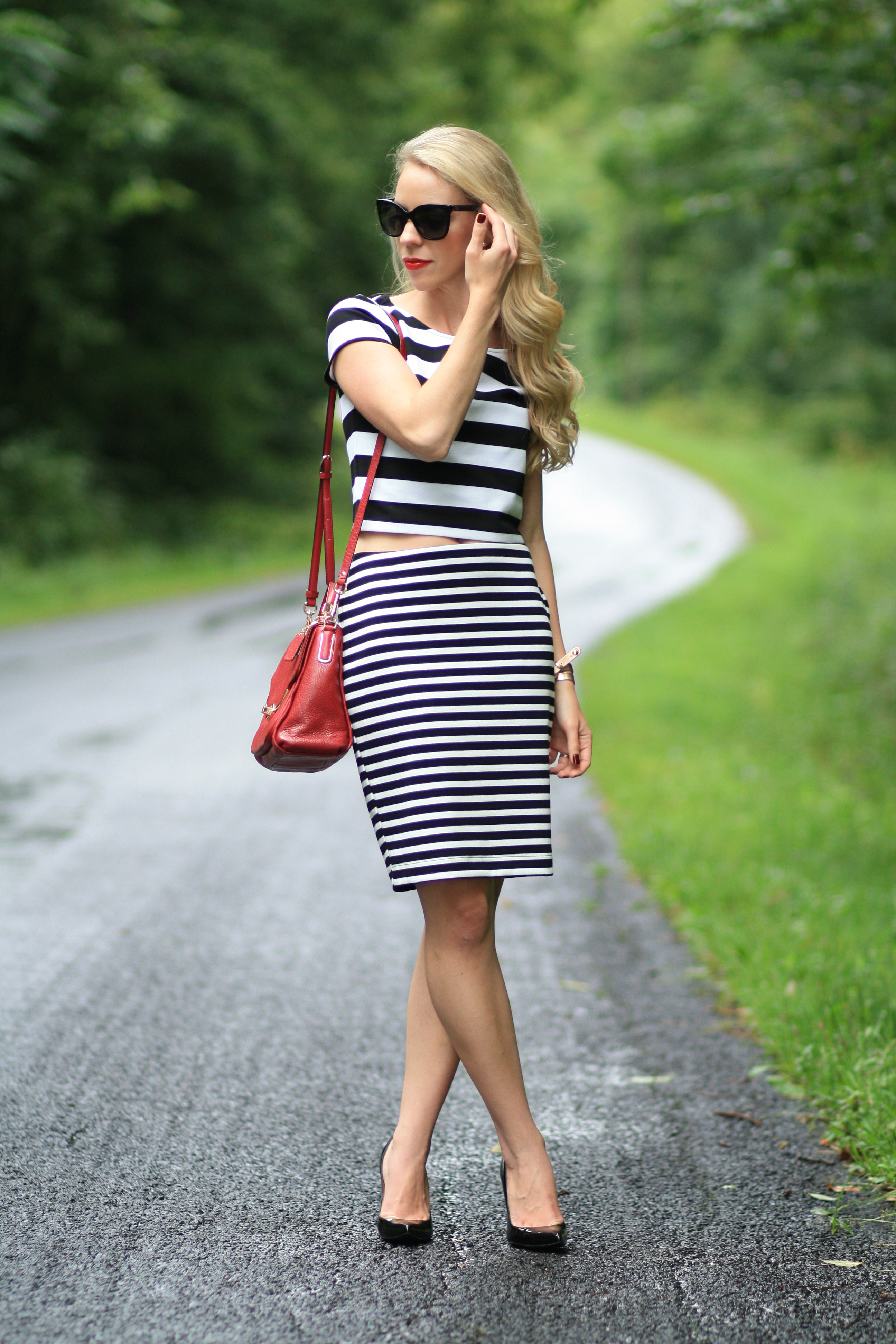 Black dress with red bag -  Stripe Black And White Striped Crop Top Black And White Striped Pencil Skirt Coach Red