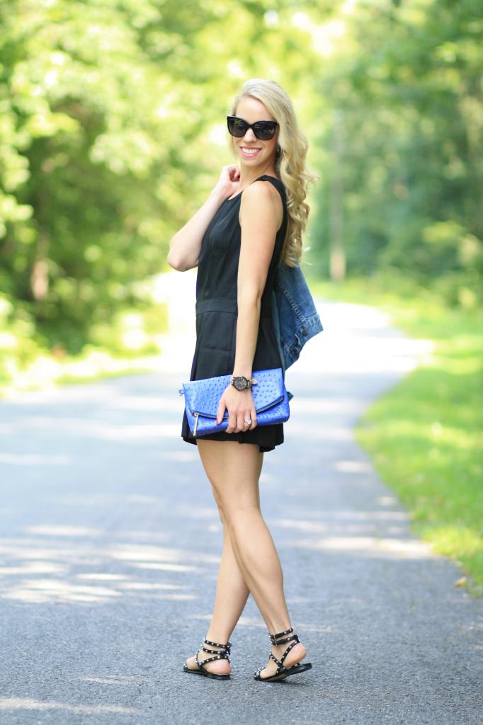 sleeveless black romper, black Chanel oversize cateye sunglasses, electric blue Normany Duxbury Brahmin clutch, Sam Edelman studded black gladiator sandals