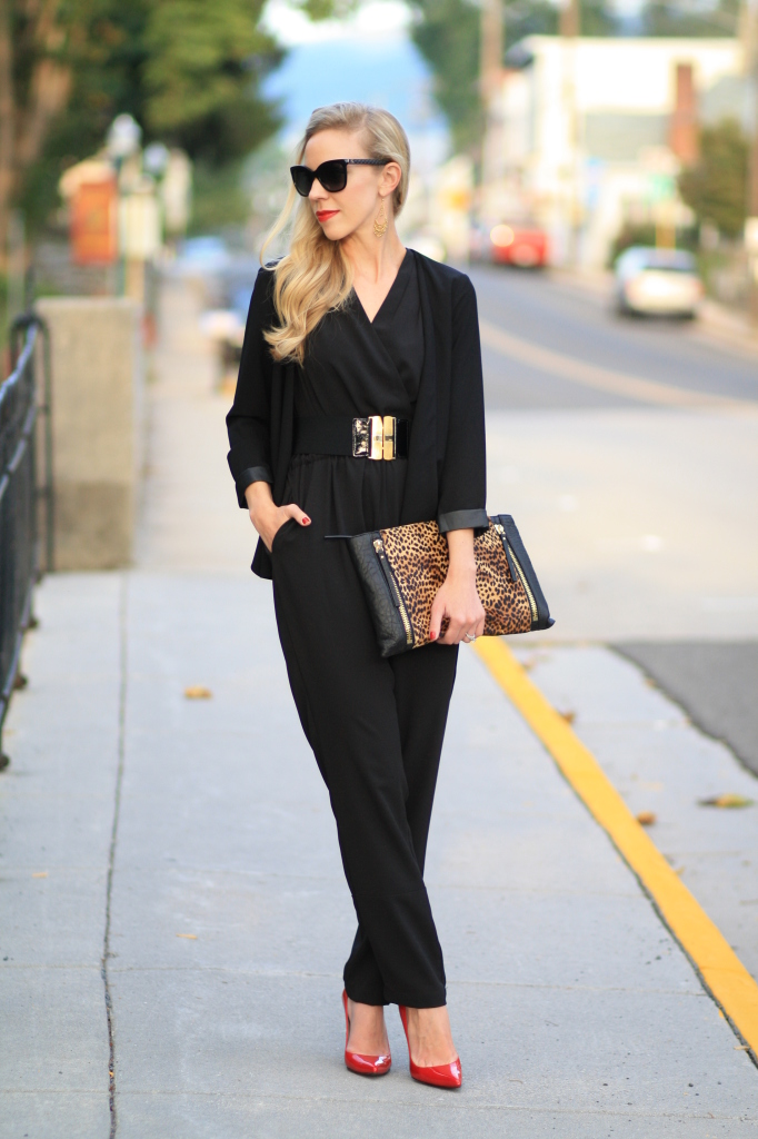 black blazer with leather trim, black jumpsuit, how to wear a jumpsuit for fall, wide waist belt gold buckle, oversized leopard clutch, Stuart Weitzman raspberry aniline red Nouveau pump