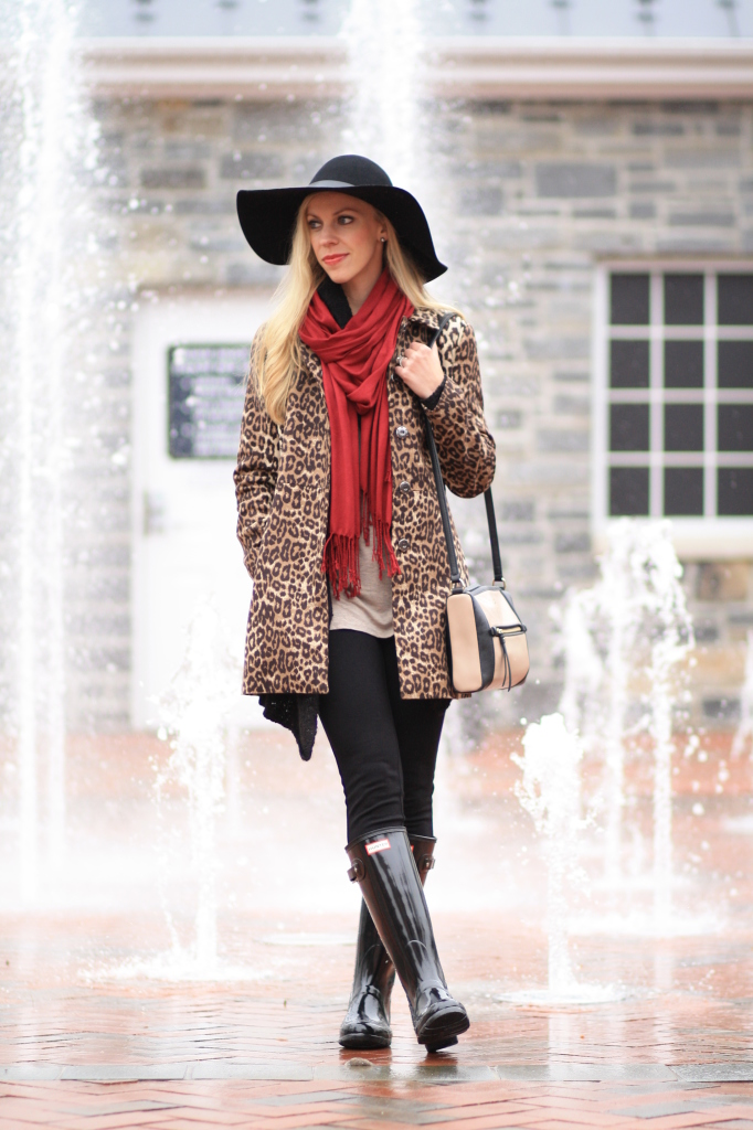H&M black floppy wool hat, leopard car coat, burgundy red scarf, black glossy Hunter boots, Hunter boots with leggings, Kate Spade colorblock black and tan bag