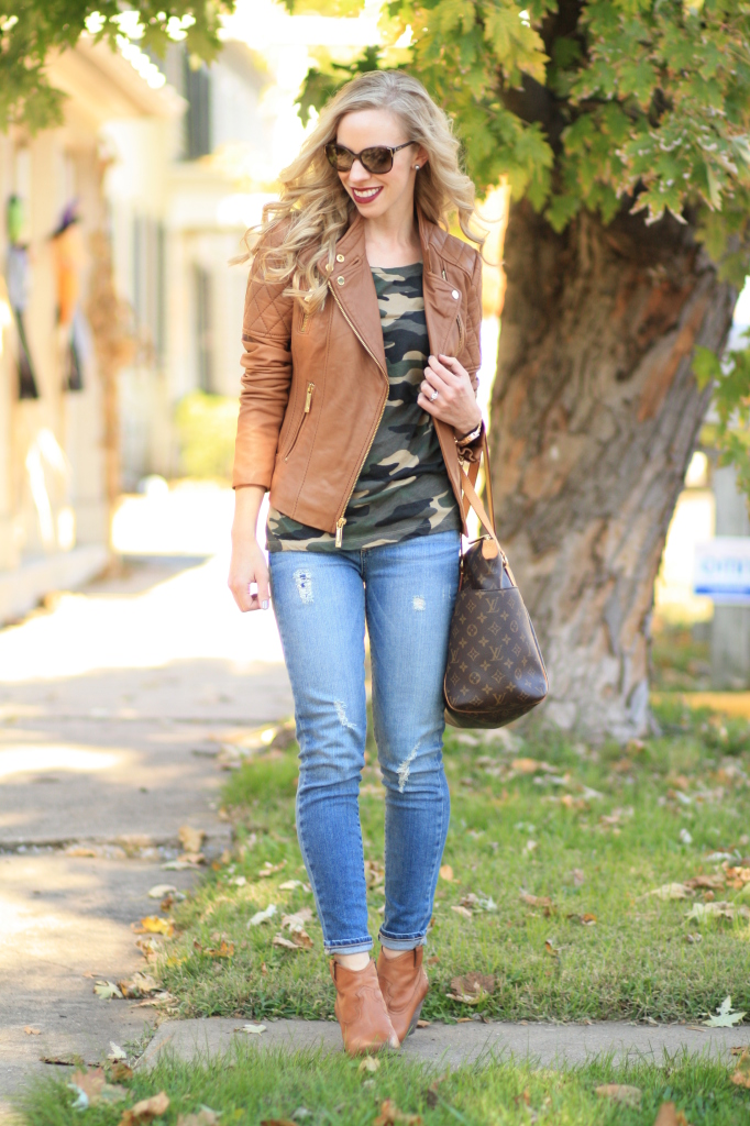 Michael Kors quilted tan leather moto jacket with gold hardware, J. Crew vintage camo tee, Paige hendrix verdugo distrssed ankle jeans, Frye camel leather Reina ankle bootie, Louis Vuitton Totally MM tote