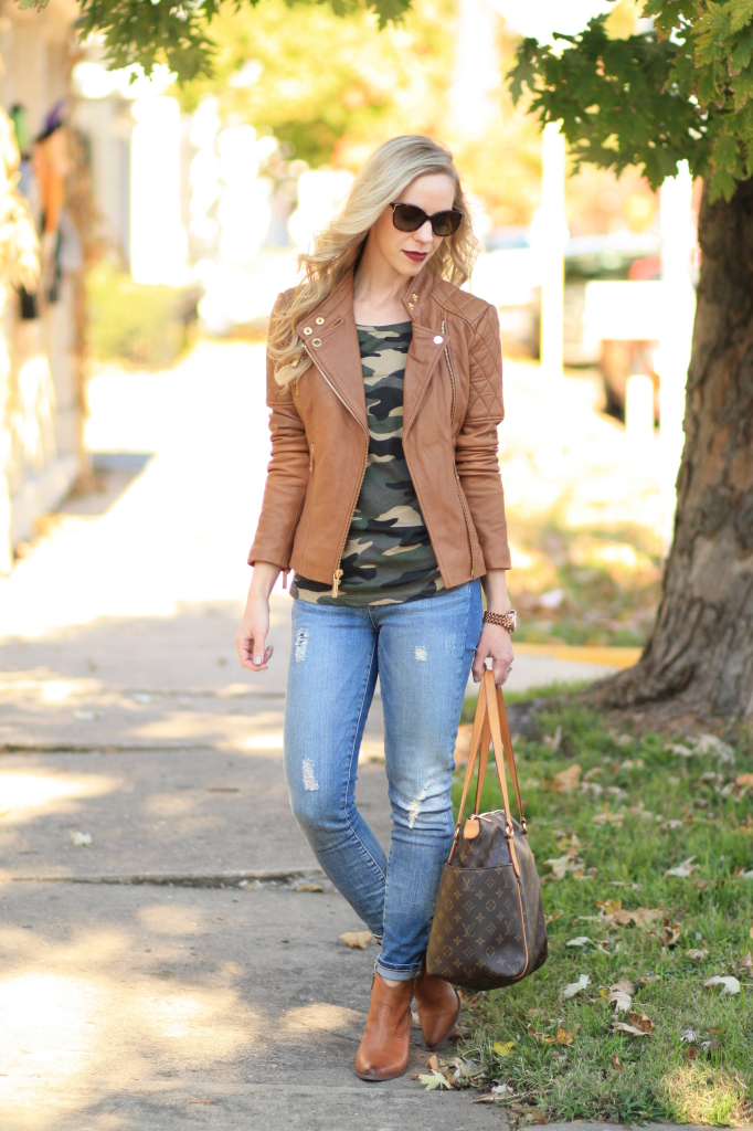 Michael Kors tan leather moto jacket, camo tee shirt, Paige Verdugo distressed ankle denim, Frye camel Reina bootie, Louis Vuitton Totally MM tote, leather jacket and camo