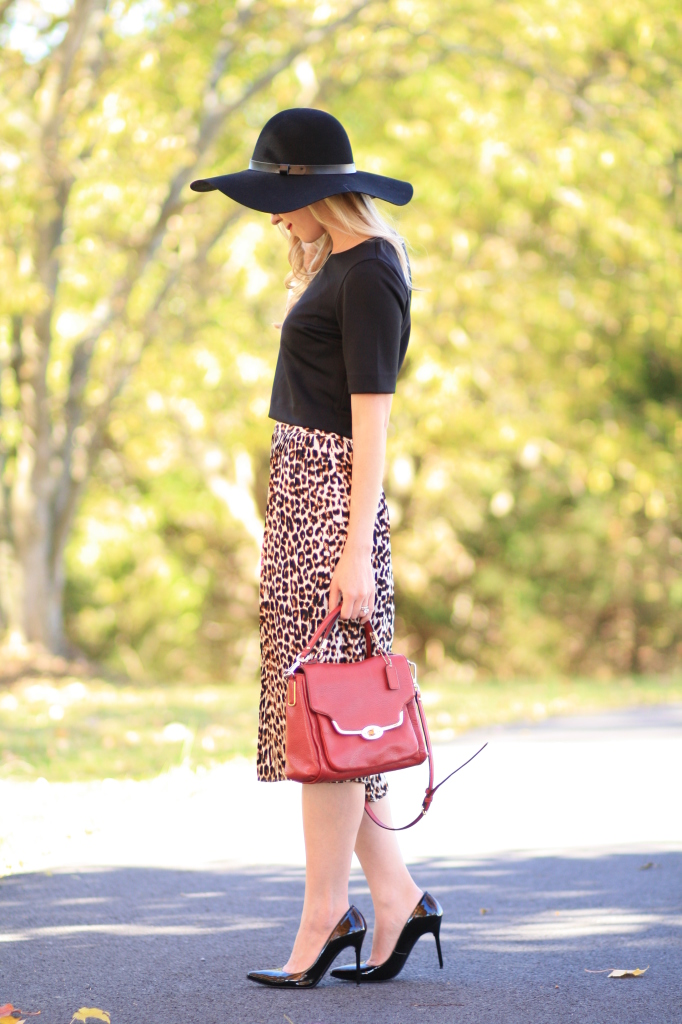 black wool floppy hat, black crop top, leopard midi skirt, red Coach Madison leather bag, Stuart Weitzman black patent Nouveau pump, fall outfit with hat