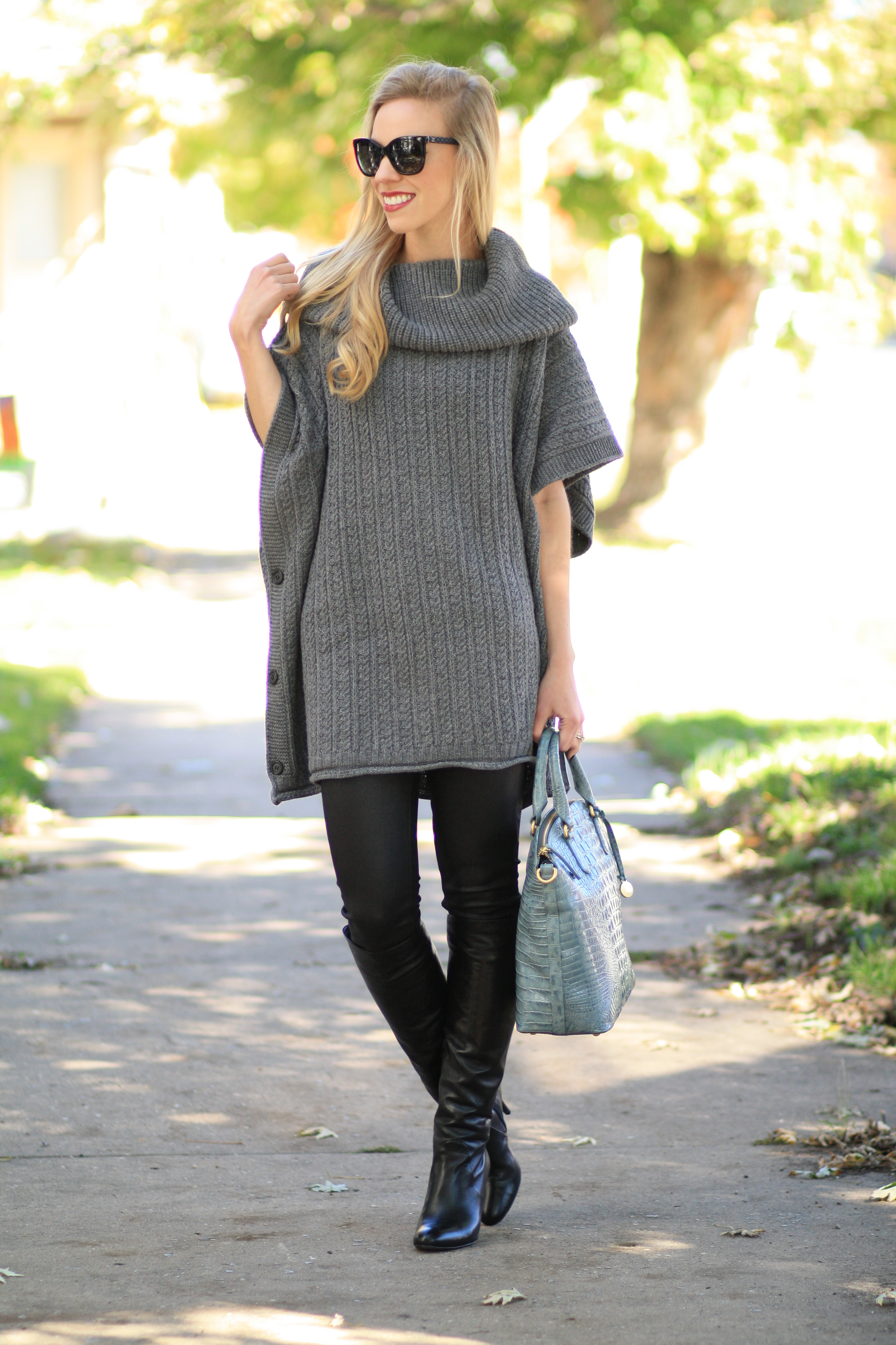 gray cable cowlneck poncho sweater, leather legging jeans