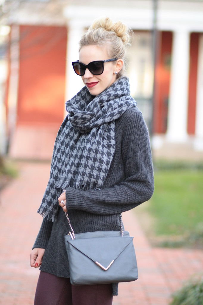 J. Crew gray houndstooth oversized scarf, oversized gray tunic sweater, burgundy leather skinny jeans, Elaine Turner gray Bailey envelope clutch crossbody bag, black Chanel cateye leather trim sunglasses