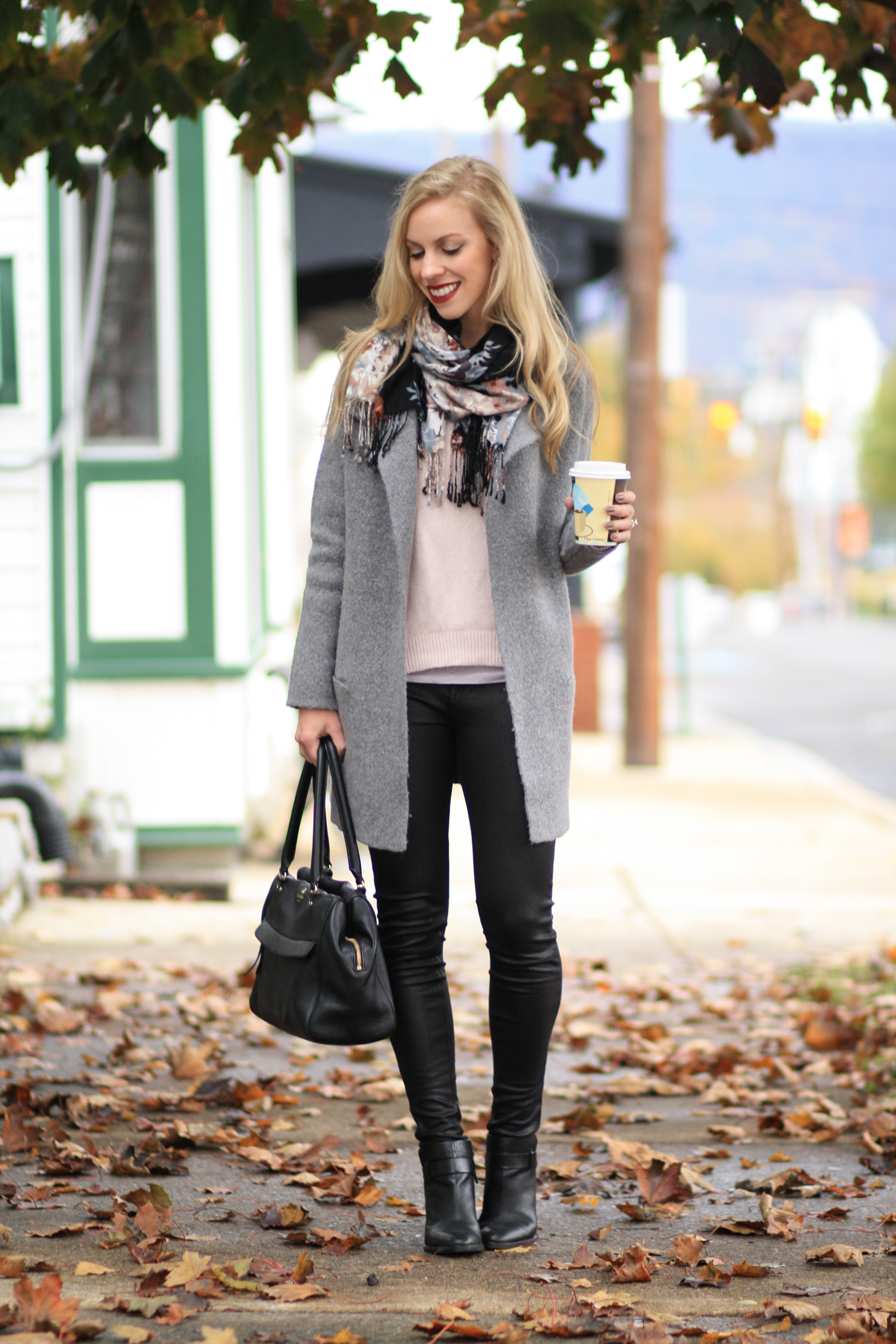 Layered Warmth: Sweater coat, Floral scarf & Leather legging denim }