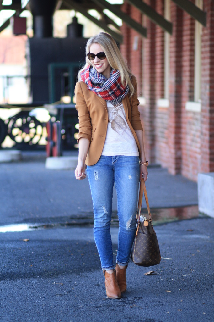 J. Crew camel blazer, deer print shirt, red plaid oversized scarf, holiday outfit, distressed denim, Frye Reina camel leather western ankle boots, Louis Vuitton totally MM tote