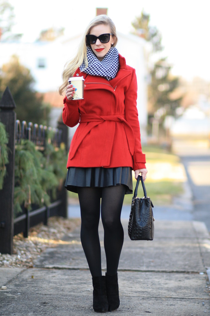bright red wrap coat, black and white houndstooth scarf, Chanel cateye sunglasses, leather skater skirt with tights and ankle booties, Brahmin small lincoln satchel, black, white and red winter outfit, holiday style
