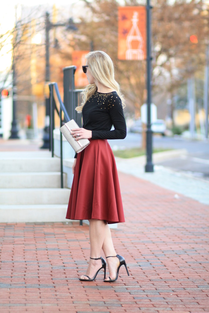 burgundy midi skirt, sequin top, black and burgundy, holiday outfit, holiday style, gold clutch, Stuart Weitzman Nudist black stiletto sandal, holiday party look
