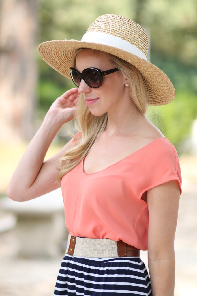 J. Crew wide brimmed straw hat, Chanel tortoiseshell oversized sunglasses, coral top, navy striped maxi skirt