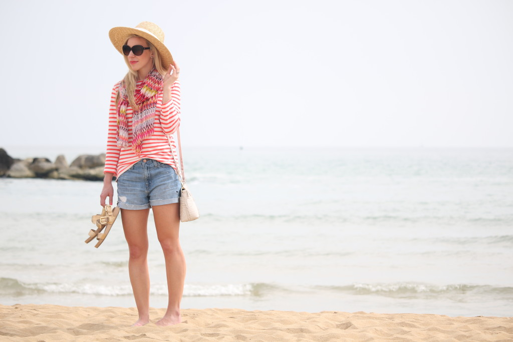 J Crew orange striped boatneck tee, wide brimmed straw hat, high rise denim boyfriend shorts, how to mix stripes with other patterns, colorful summer outfit for the beach