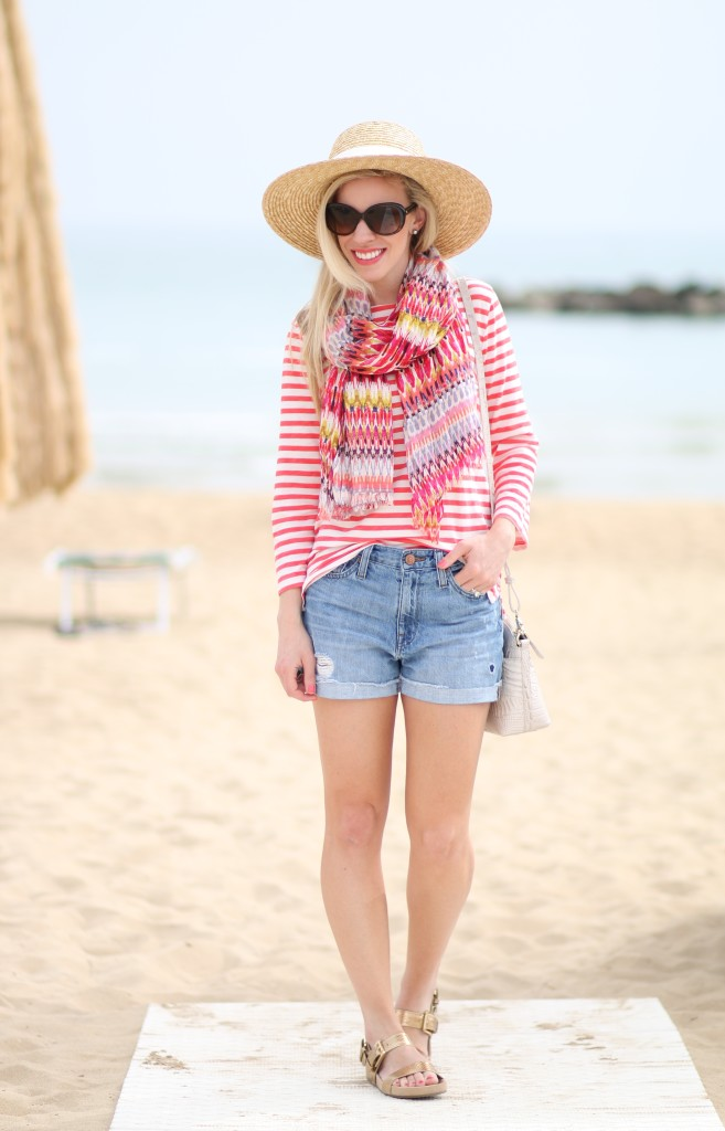 J Crew striped boatneck tee, colorful pattern summer scarf, how to mix patterns, J Crew wide brimmed straw hat, Michael Kors Sawyer gold sandals, high rise distressed shorts