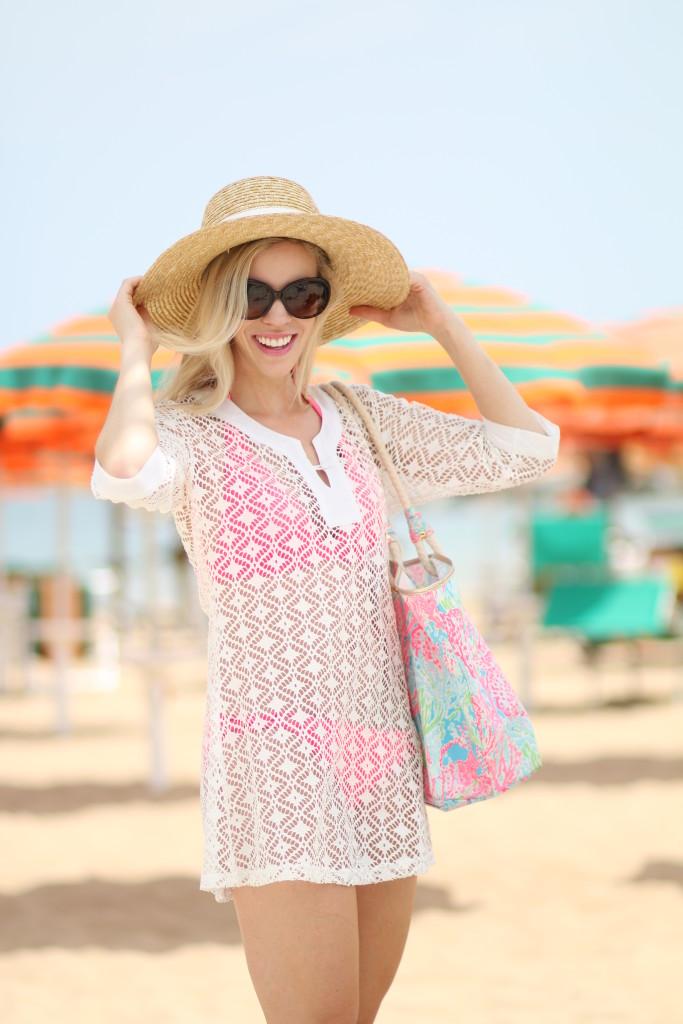 J. Crew wide brimmed straw hat, Chanel tortoiseshell sunglasses, white crochet beach cover-up, Victoria's Secret coral pink halter bikini, Lilly Pulitzer coral print beach tote
