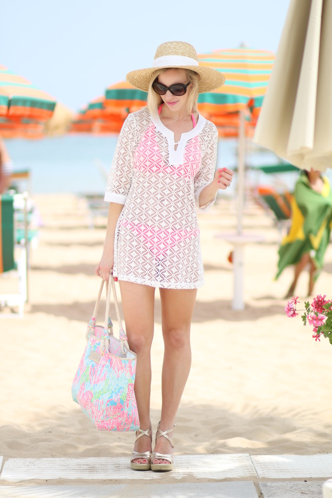 J. Crew wide brimmed straw hat, white lace eyelet swimsuit cover up, Lilly Pulitzer coral print tote, gold wedge sandals, how to look stylish at the beach