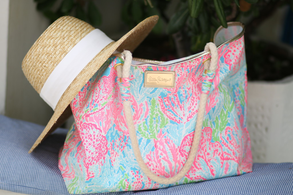 Lilly Pulitzer coral beach tote with rope handles, J. Crew wide brimmed straw hat