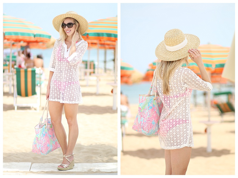 white crochet lace beach cover-up, Lilly Pulitzer coral reef blue and pink beach tote, Tommy Hilfiger gold wedge sandals, J. Crew wide brimmed straw hat, white cover up beach outfit