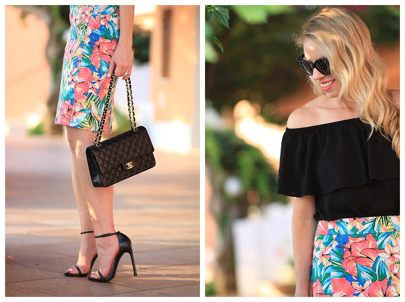 Chanel medium classic flap bag black lambskin with gold hardware, tropical print skirt, black off the shoulder blouse, Stuart Weitzman black Nudist stiletto sandals