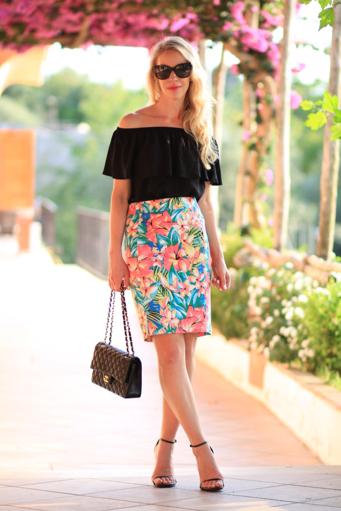 Express off the shoulder black top, off the shoulder top with pencil skirt, tropical print skirt, Stuart Weitzman black leather Nudist sandal, Chanel, what to wear to Capri