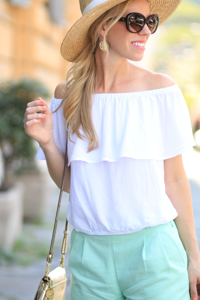 Express white off the shoulder top, J. Crew mint shorts, Brahmin gold crossbody bag, Chanel oversized tortoiseshell sunglasses, wide brim hat with off the shoulder top