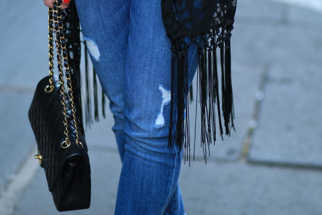 distressed boyfriend jeans, fringed cardigan, Chanel classic medium flap bag black lambskin with gold hardware