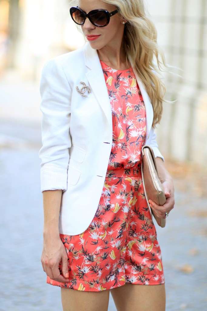 palm print romper, J Crew white blazer, gold Chanel brooch on blazer jacket, Estee Lauder Surreal Sun coral lipstick