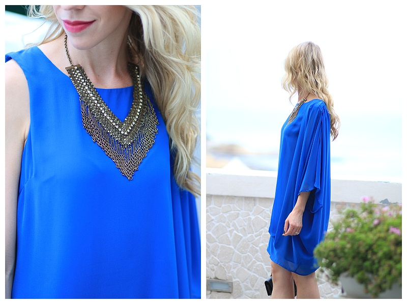 Chanel La Romanesque lipstick, gold statement necklace with dress, cobalt blue flowy one shoulder dress