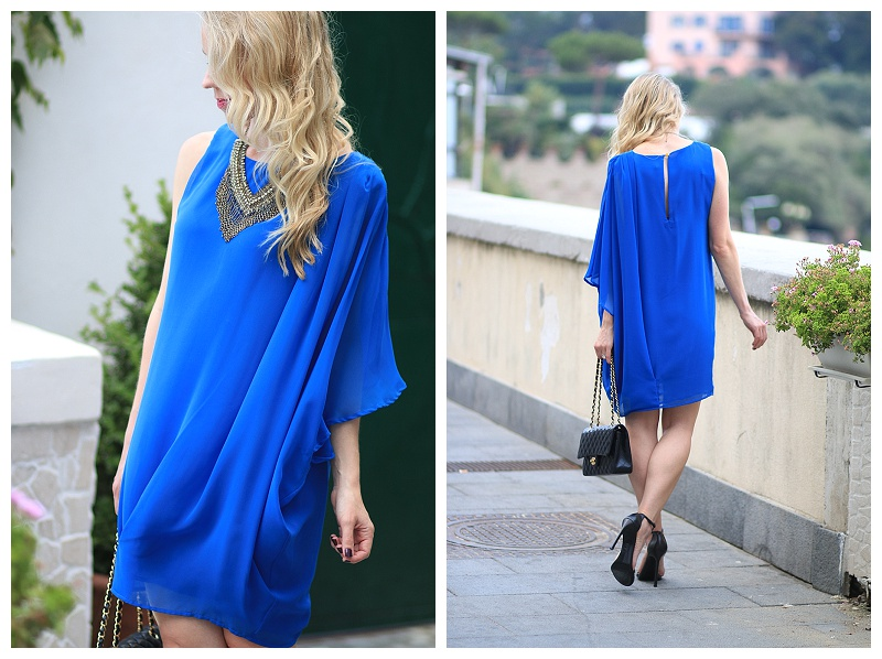 cobalt blue grecian one shoulder dress, flowy dress, Chanel classic flap bag, how to wear a statement necklace for evening
