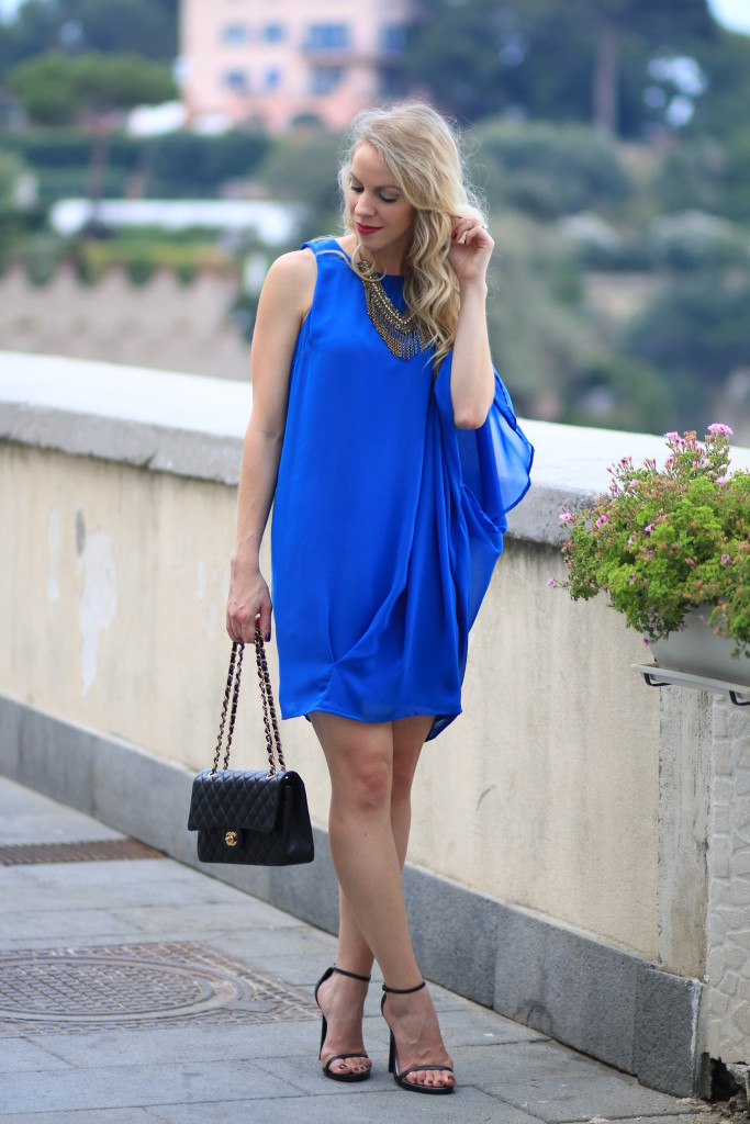 cobalt blue one shoulder Grecian style dress, Chanel medium classic bag black lambskin with gold hardware, how to wear one shoulder dress