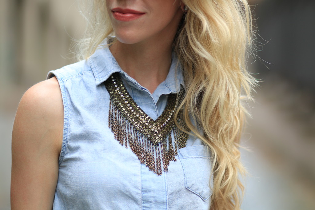 gold fringe statement necklace, Bare Minerals Dim the Lights lipstick, sleeveless chambray top with statement necklace