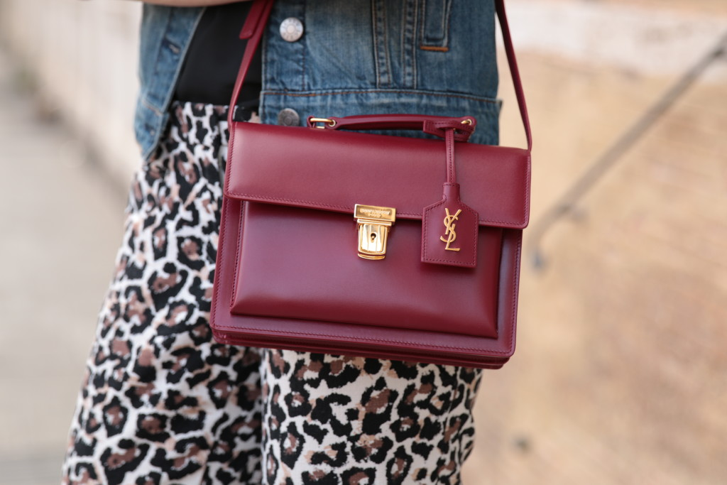 1b76e6c064f oxblood St. Laurent 'High School' satchel, leopard print with red outfit,  denim vest with leopard pants