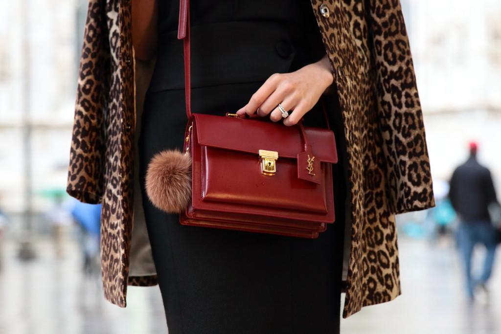 e3f3bdeb029 Saint Laurent oxblood High School satchel, red YSL bag, fur puff keychain,  leopard coat with red bag, Milan Fashion Week 2015