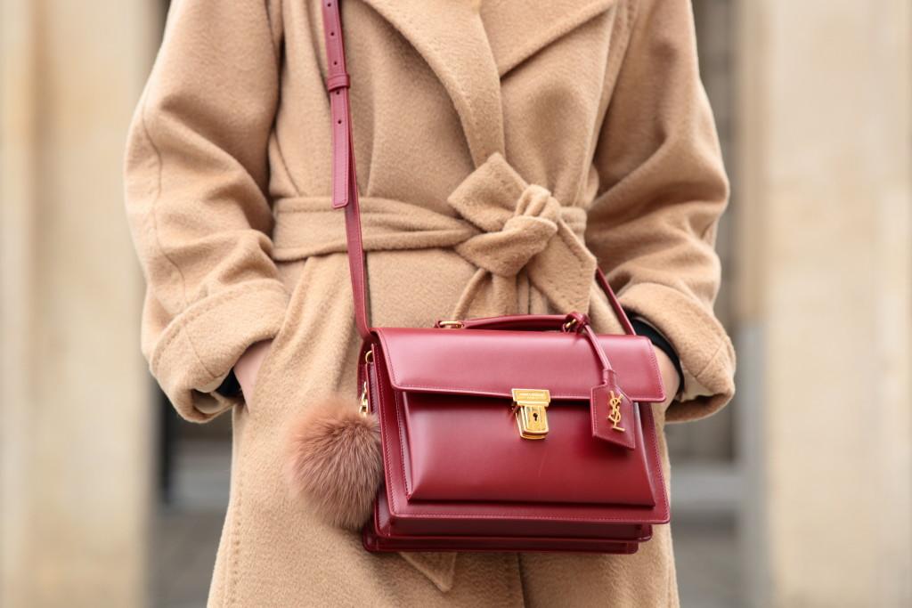 d718820bf62 Saint Laurent high school satchel oxblood, fur puff keychain on handbag,  Max Mara Manuela camel coat, how to tie belt on a winter coat