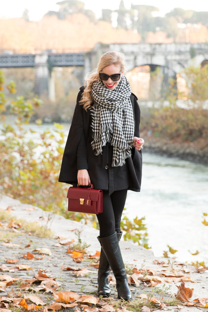 black cape with houndstooth scarf winter outfit, red and houndstooth, holiday outfit with cape, all black outfit, fashion blogger Rome Italy