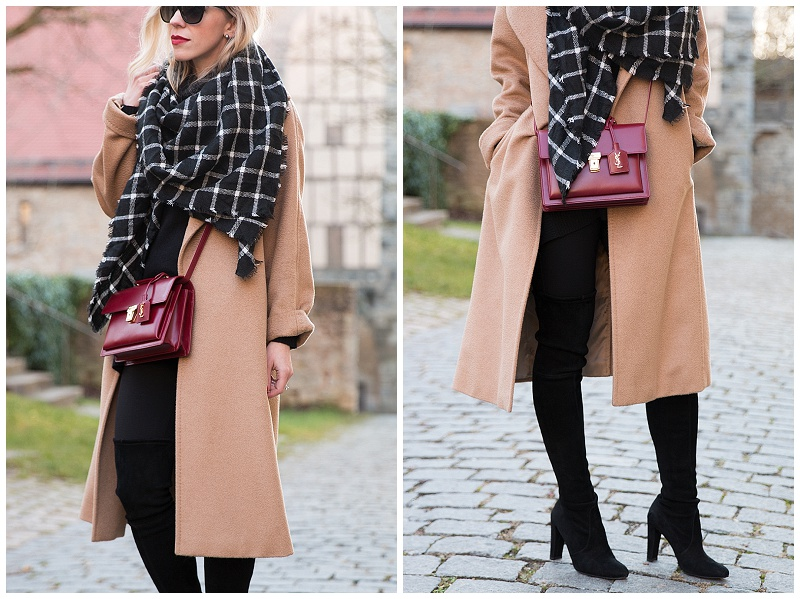Max Mara camel coat, camel coat with black and white plaid blanket scarf, Stuart Weitzman Highland black suede boots, long camel coat worn open with thigh high boots