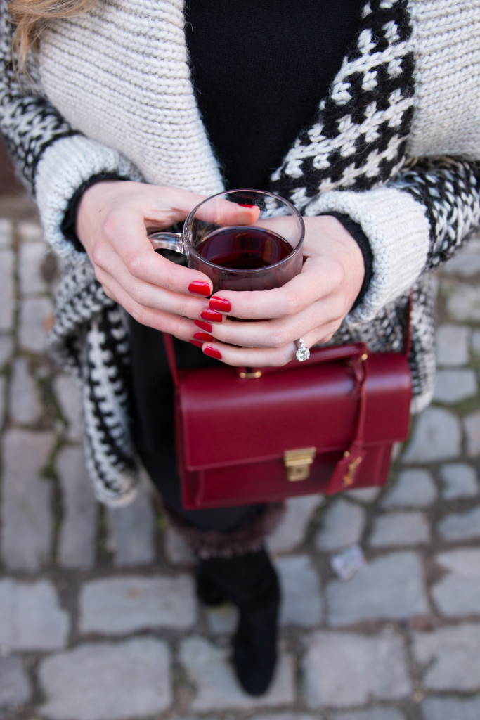 Saint Laurent high school satchel oxblood, black and white Nordic print sweater, OPI what's your poinsettia red nails