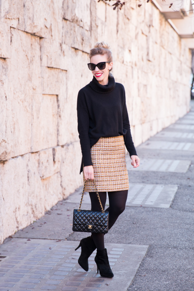 black oversized relaxed fit turtleneck with mini skirt outfit, J. Crew sparkle tweed mini skirt with tights and boots, Chanel medium classic black lambskin gold hardware
