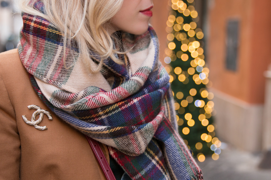red green blue plaid blanket scarf, Chanel gold brooch pin on blazer, camel blazer with brooch, plaid scarf holiday outfit