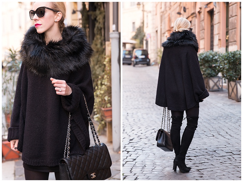 Michael Kors black poncho with faux fur collar, all black winter outfit with thigh high boots, Stuart Weitzman black suede Highland boots with poncho and sweater dress