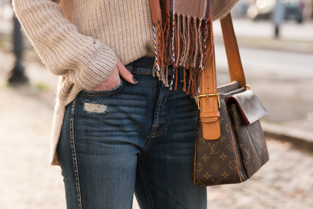 distressed flare jeans with oversized sweater, vintage Louis Vuitton monogram bag