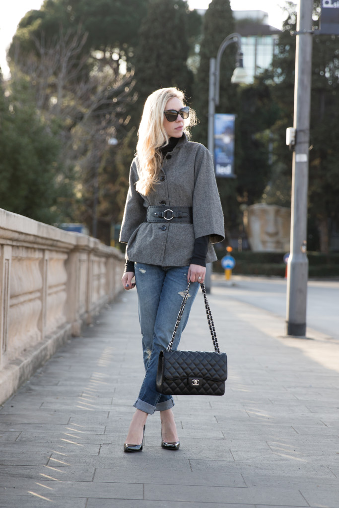 black and white tweed jacket belted at waist, boyfriend jeans with blazer and pumps, Chanel Jumbo classic flap bag black caviar silver hardware