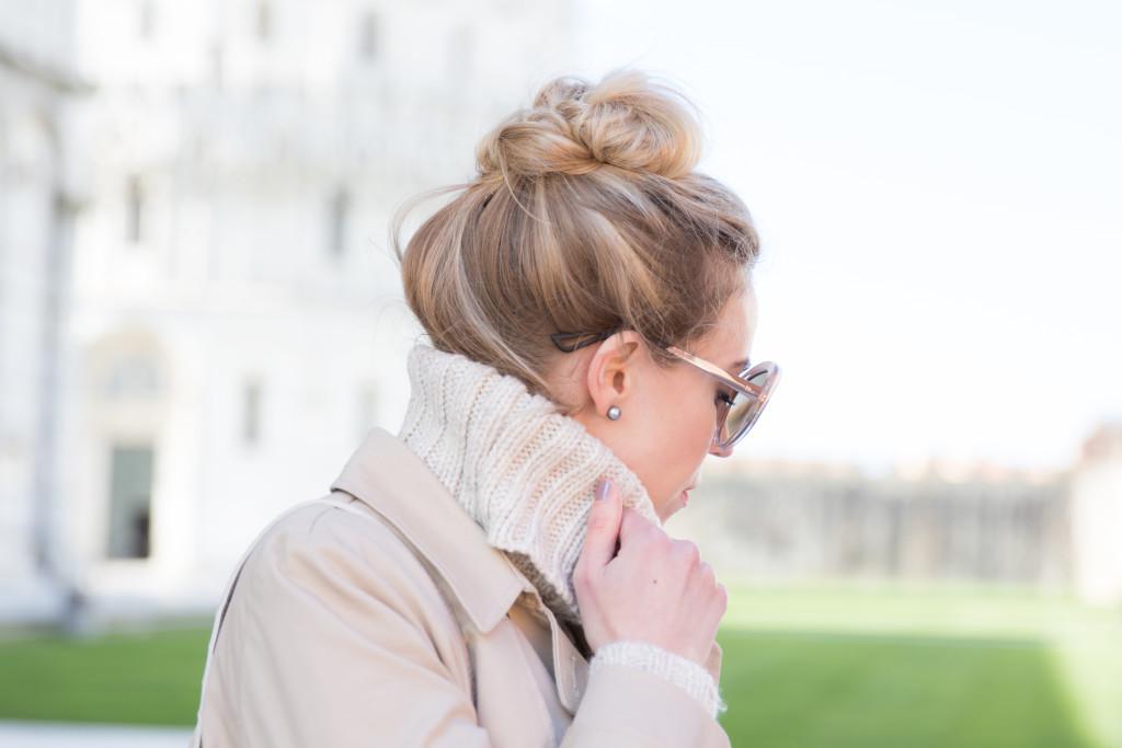 topknot, Dior oversized beige Extase sunglasses, khaki trenchcoat with turtleneck
