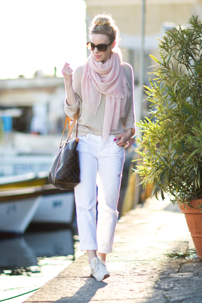 blush pink scarf with beige sweater outfit, white boyfriend jeans, how to wear pink and white for spring, gold New Balance sneakers outfit