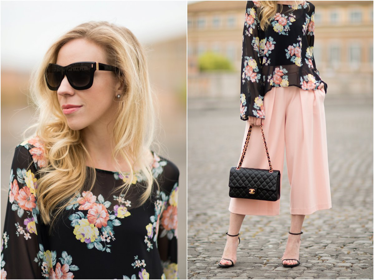 Escada black sunglasses, floral print bell sleeve top, pink culottes outfit, Chanel medium classic flap bag black lambskin with gold hardware