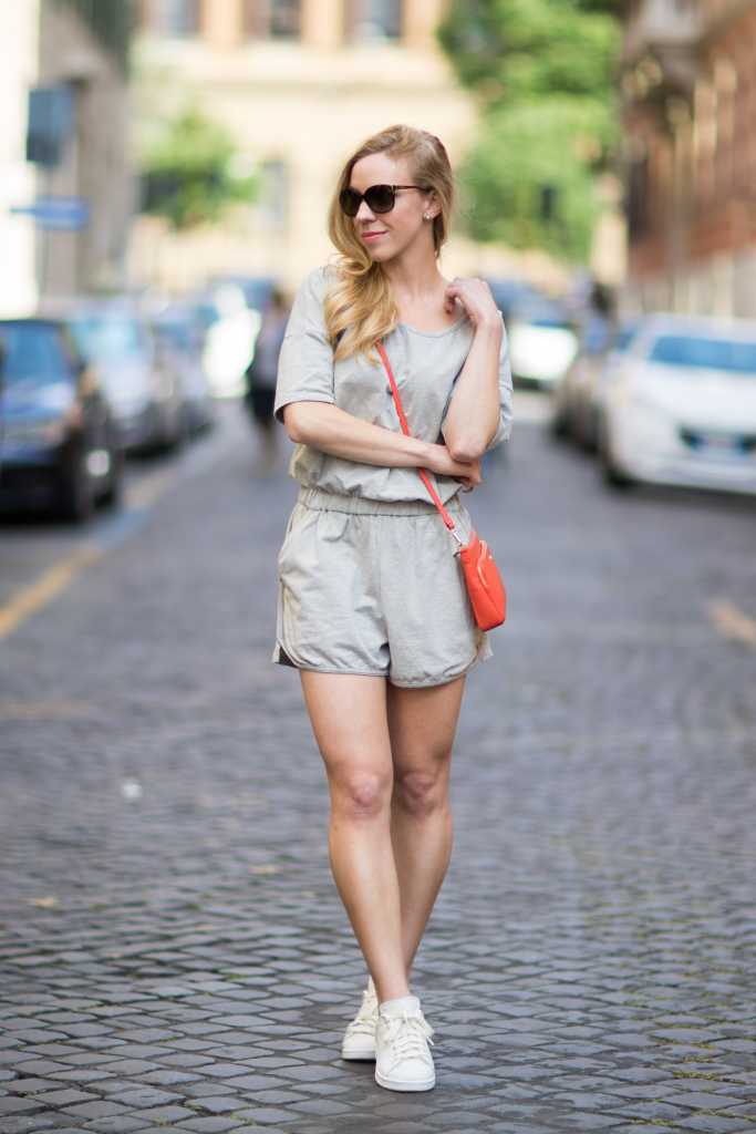 Gray romper, orange crossbody bag, Adidas Stan Smith sneakers, casual romper outfit with sneakers