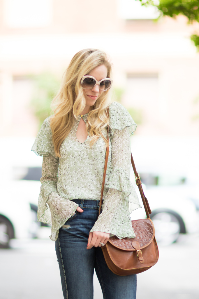 H&M mint floral ruffle sleeve blouse, vintage Brahmin tan leather saddle bag, bell sleeve blouse with flare jeans outfit