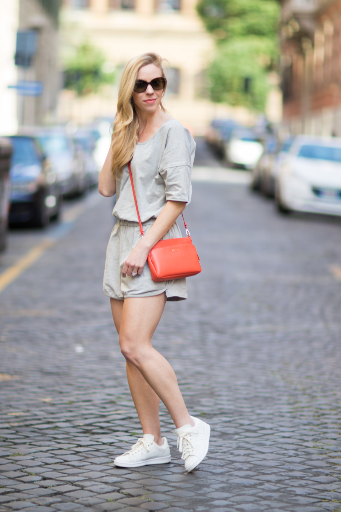 gray SheIn romper, Adidas Stan Smith reptile print sneakers, Furla orange handbag, how to wear a romper with sneakers
