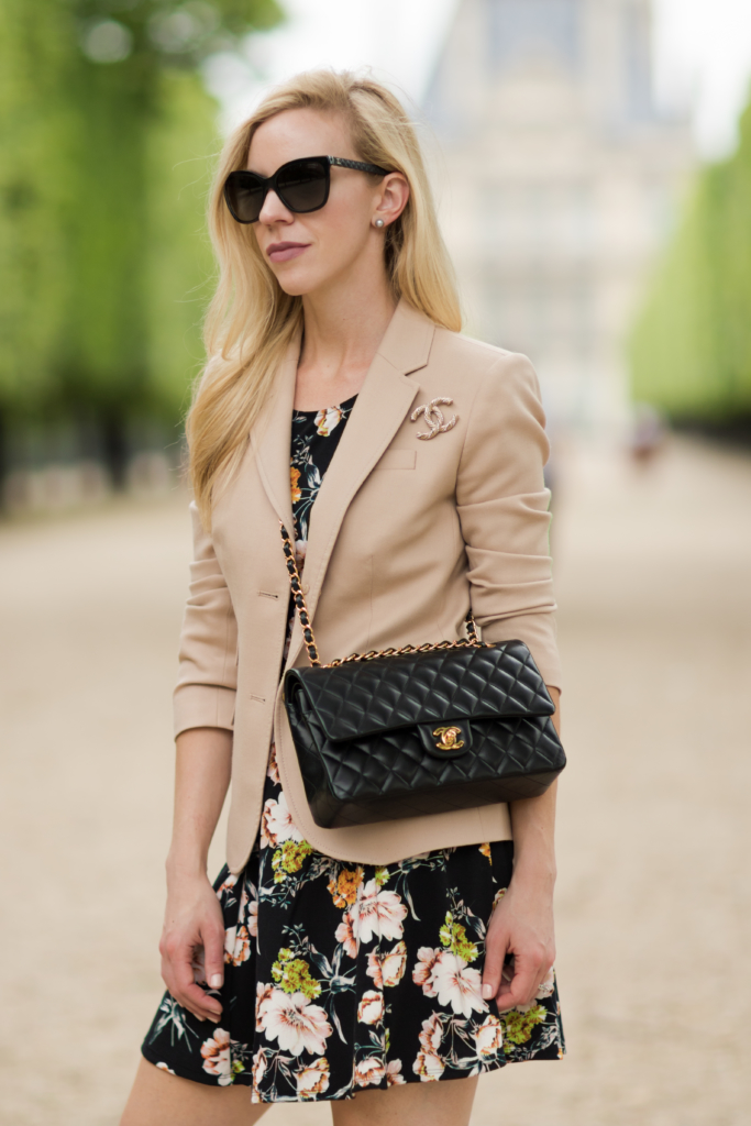 blush pink blazer worn over floral print dress, blush pink blazer with Chanel gold brooch pin, Chanel medium classic flap bag black with gold hardware